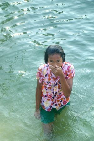 Thai girl in water.jpg
